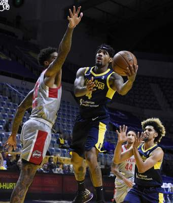 Rachel Von Stroup | The Journal Gazette  The Mad Ants' Walt Lemon Jr. goes up for a shot over Rio Grande Valley's Ray Spalding during the first quarter at the Memorial Coliseum on Monday night.