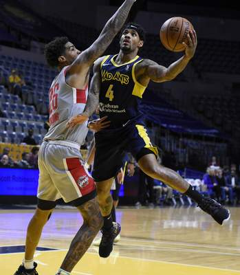 Rachel Von Stroup | The Journal Gazette  The Mad Ants' Walt Lemon, Jr. shoots the ball over Rio Grande Valley's Ray Spalding during the first quarter at the Memorial Coliseum on Monday night.
