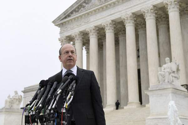 Attorney Paul Clement makes a statement outside of the Supreme Court in Washington, Monday, Dec. 2, 2019, following arguments in the first gun rights case before the Supreme Court in nine years. The case was filed by three New York City gun owners who are challenging a ban on carrying a licensed handgun outside city limits to a gun range, shooting competition or second home outside city limits. (AP Photo/Susan Walsh)
