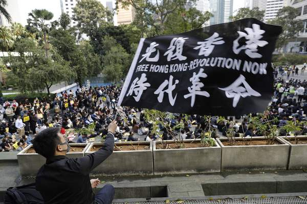 A pro-democracy supporter waves a flag during a rally by the advertising industry in Hong Kong on Monday, Dec. 2, 2019. (AP Photo/Vincent Thian)