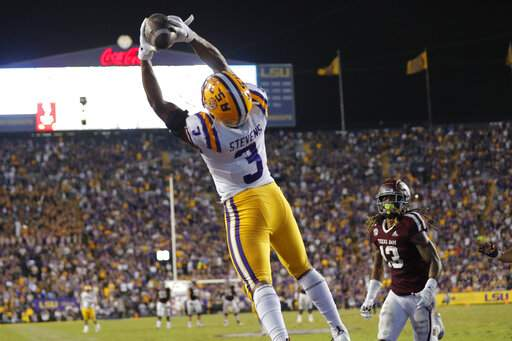 LSU safety JaCoby Stevens (3) pulls in an interception in the end zone on a pass intended for Texas A&M wide receiver Kendrick Rogers (13) during the second half of an NCAA college football game in Baton Rouge, La., Saturday, Nov. 30, 2019. LSU won 50-7. (AP Photo/Gerald Herbert)
