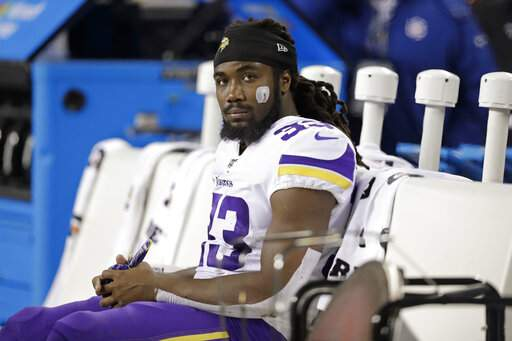 Minnesota Vikings' Dalvin Cook sits on the bench during the second half of an NFL football game against the Seattle Seahawks, Monday, Dec. 2, 2019, in Seattle. (AP Photo/John Froschauer)