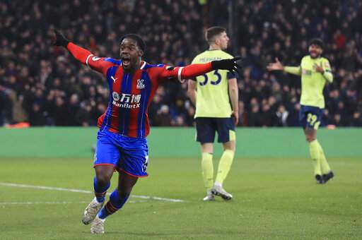 Crystal Palace's Jeffrey Schlupp celebrates scoring his side's first goal of the game against Bournemouth, during their English Premier League soccer match at Selhurst Park in London, Tuesday Dec. 3, 2019. (Adam Davy/PA via AP)