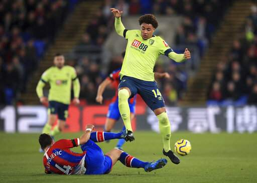 Crystal Palace's Luka Milivojevic, left, tackles Bournemouth's Arnaut Danjuma during their English Premier League soccer match at Selhurst Park in London, Tuesday Dec. 3, 2019. (Adam Davy/PA via AP)