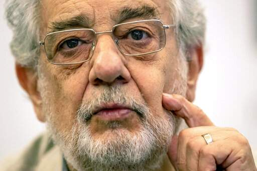 FILE - In this July 12, 2019, file photo, opera singer Placido Domingo speaks during a news conference about his upcoming show