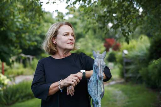 FILE - In this July 12, 2019, file photo, former opera singer Patricia Wulf, poses for a portrait in her home in Virginia. Wulf and Angela Turner Wilson, who have accused Placido Domingo of sexual misconduct reacted angrily to his claims in recent interviews that he never behaved improperly and always acted gallantly and like a gentleman with women. They issued a statement Tuesday, Dec. 3, 2019, saying they found Domingo's comments and his