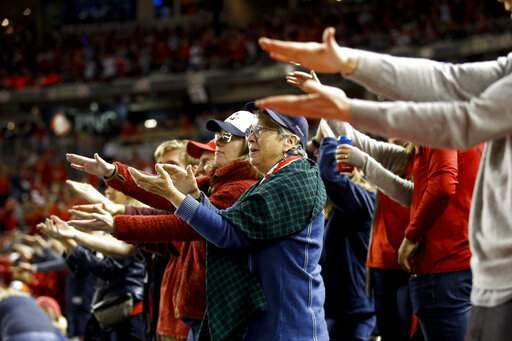 FILE - In this Oct. 25, 2019, file photo, fans gesture the baby shark as Washington Nationals' Gerardo Parra bats during the sixth inning of Game 3 of the baseball World Series against the Houston Astros, in Washington. Creators of the viral video
