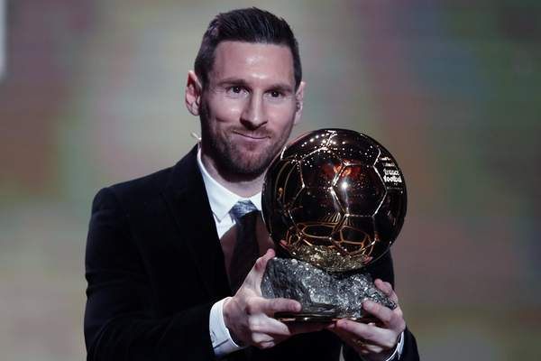 Associated Press Lionel Messi holds the Ballon d'Or, awarded to soccer's top player, Monday in Paris.