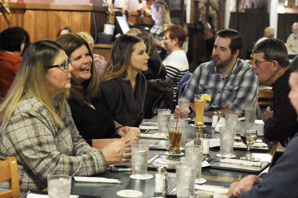 Photos by Rachel Von Stroup | The Journal Gazette Members of the Racine family meet at Henry's in downtown Fort Wayne to discuss upcoming Racine Acts of Kindness. The siblings meet every three months to talk about what they've done to help others and plan future acts.