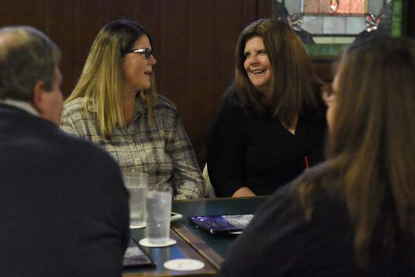 Jean McCoy, left, and Julie Applegate speak at the family's latest meeting. Applegate started the Racine Acts of Kindness and hopes the next generation picks it up.