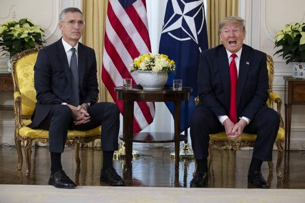 U.S. President Donald Trump speaks during a meeting with NATO Secretary General, Jens Stoltenberg at Winfield House in London, Tuesday, Dec. 3, 2019.(AP Photo/Evan Vucci)