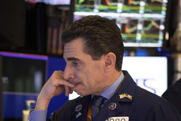 Trader Peter Mazza works at the New York Stock Exchange, Tuesday, Dec. 3, 2019. Stocks fell broadly Tuesday after President Donald Trump cast doubt over the potential for a trade deal with China this year and threatened to impose tariffs on French goods. (AP Photo/Mark Lennihan)