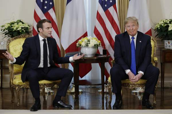 Associated Press President Donald Trump meets French President Emmanuel Macron on Tuesday at Winfield House in London.
