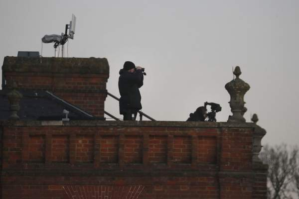Security forces are positioned on the roof of the Grove hotel and resort where NATO leaders are meeting in Watford, Hertfordshire, England, Wednesday, Dec. 4, 2019. (AP Photo/Frank Augstein)