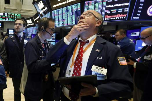 Financial Markets Wall Street Associated Press Trader Frederick Reimer works on the floor of the New York Stock Exchange on Wednesday as traders become more hopeful that a trade deal between the U.S. and China is making progress.  (Richard DrewSTF)