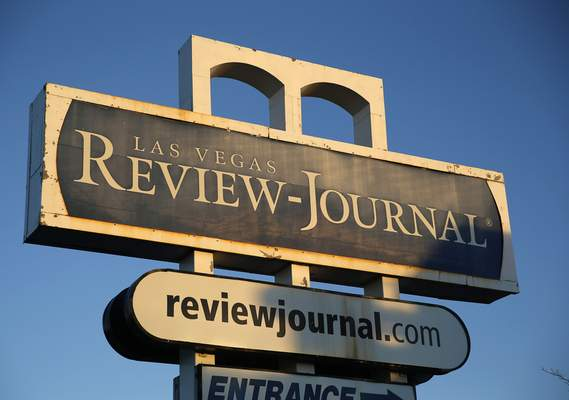 FILE - This Dec. 17, 2015 file photo shows a sign outside the building housing the Las Vegas Review-Journal in Las Vegas. (AP Photo/John Locher, File)