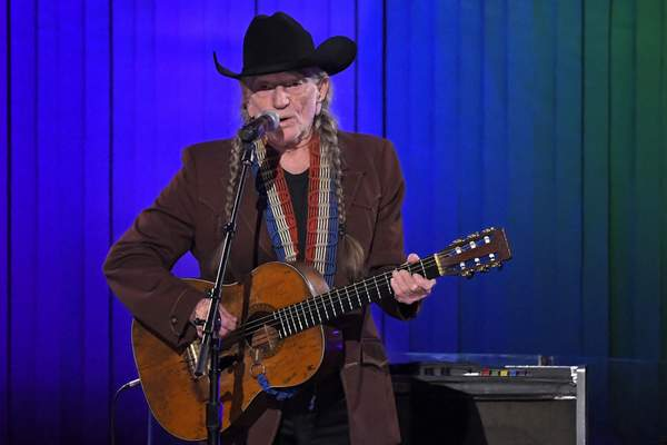 FILE - In this Nov. 13, 2019, file photo, Willie Nelson performs in Nashville, Tenn. Nelson may have given up smoking, but he hasn't stopped using marijuana. (AP Photo/Mark J. Terrill, File)