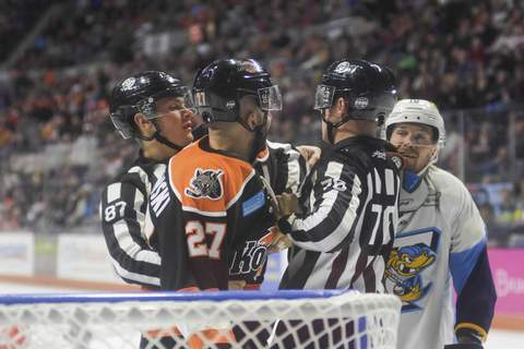Katie Fyfe | Journal Gazette  The Komets' Shawn Szydlowski and Toledo's Alex Kromm get into a fight during the second period at Memorial Coliseum on Friday.