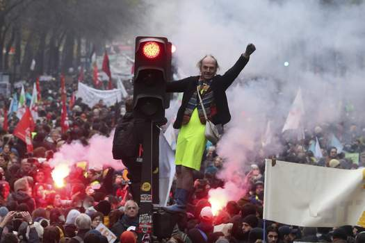 APTOPIX France Strikes Associated Press A man stands on a traffic signal during union demonstrations in Parison Thursday. (Thibault CamusSTF)
