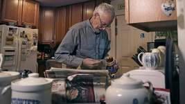 Alzheimer Drug Associated Press Charles Flagg, who has Alzheimer's, makes a sandwich in Jamestown, R.I. Its developers say the drug aducanumab slows mental decline from the disease.  (Charles KrupaSTF)