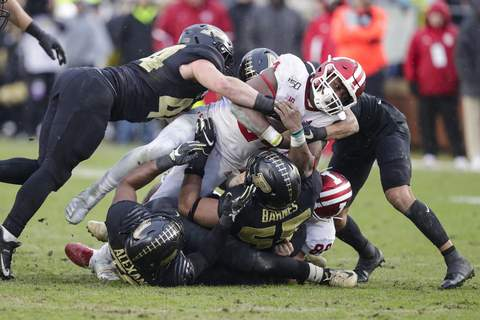 Indiana Purdue Football Indiana running back Sampson James (24) is tackled by Purdue cornerback Cam Allen (18) and linebacker Ben Holt (44) during the first half of an NCAA college football game in West Lafayette, Ind., Saturday, Nov. 30, 2019. (AP Photo/Michael Conroy) (Michael Conroy STF)