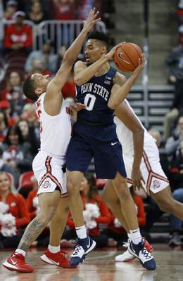 Penn State's Myreon Jones, right, looks for an open pass as Ohio State's C.J. Walker defends during the second half of an NCAA college basketball game Saturday, Dec. 7, 2019, in Columbus, Ohio. Ohio State beat Penn State 104-74. (AP Photo/Jay LaPrete)