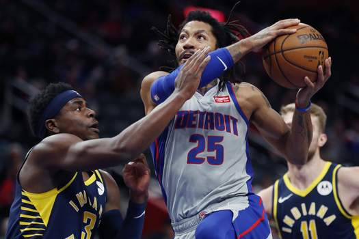 Pacers Pistons Basketball Associated Press Pistons guard Derrick Rose looks to the basket as Pacers guard Aaron Holiday defends during the first half Friday. Rose finished with 14 points.  (Carlos OsorioSTF)