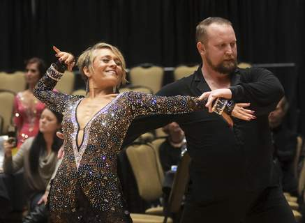 Katie Fyfe | The Journal Gazette  Student Kenna Jackson and Christopher Spalding, co-owner of Fort Wayne Ballroom Company, perform Saturday during the2019 Winter Solstice Dancesport Challenge at the Allen County War Memorial Coliseum.