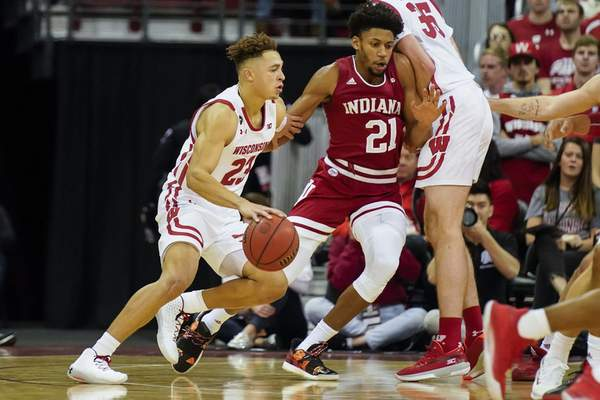 Associated Press Wisconsin's Kobe King drives against Indiana's Jerome Hunter during the first half Saturday in Madison, Wis. King had a game-high 24 points to lead the Badgers.