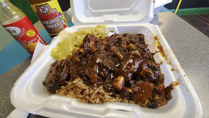 Oxtail dinner at Pepper & Spice Jamaican Restaurant on Lower Huntington Road.