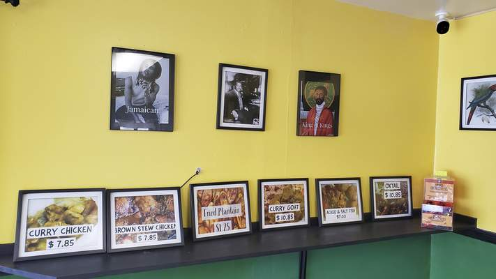 The little dining room of Pepper & Spice Jamaican Restaurant on Lower Huntington Road is decorated with photos of the food and of Jamaican celebrities.