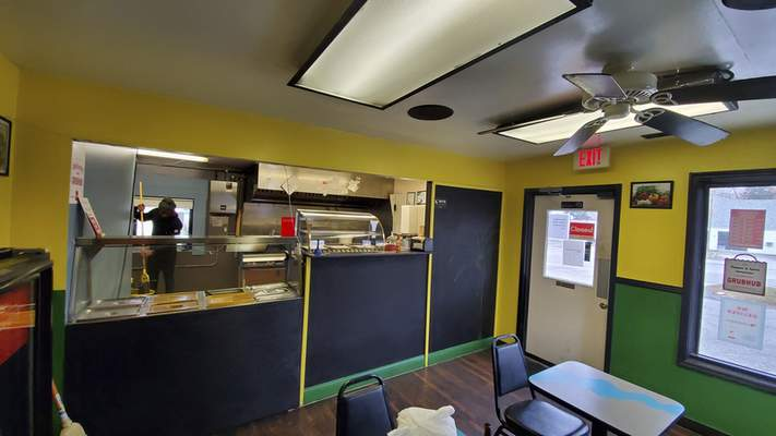 The inside of Pepper & Spice Jamaican Restaurant on Lower Huntington Road has all the bright colors of the Jamaican flag.