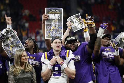 SEC Championship Football LSU QB Joe Burrow celebrates with teammates after the Tigers won the Southeastern Conference title. (John BazemoreSTF)