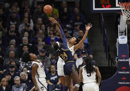 Notre Dame UConn Basketball Connecticut's Olivia Nelson-Ododa blocks a shot attempt from Notre Dame's Destinee Walker, left, as Connecticut's Christyn Williams, far left, and Crystal Dangerfield, right, defend in the first half of an NCAA college basketball game, Sunday, Dec. 8, 2019, in Storrs, Conn. (AP Photo/Jessica Hill) (Jessica Hill