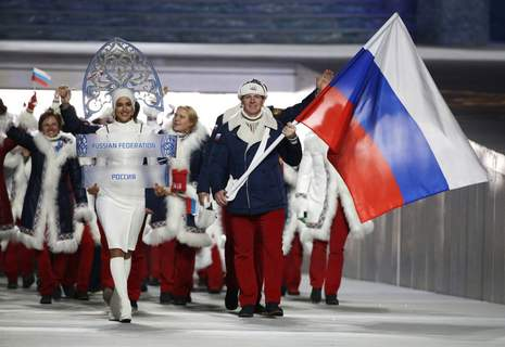 Russian Doping FILE - In this Feb. 7, 2014 file photo Alexander Zubkov of Russia carries the national flag as he leads the team during the opening ceremony of the 2014 Winter Olympics in Sochi, Russia. at left is model Irina Shayk carrying the Russian placard. (AP Photo/Mark Humphrey, file) (Mark Humphrey STF)