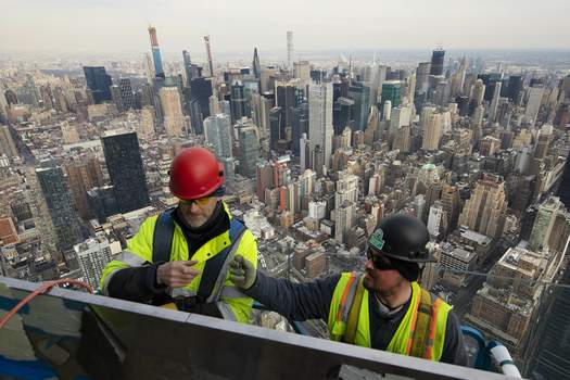 NABE Economic Outlook Associated Press Work is performed on an outdoor observation deck on the 30 Hudson Yards office building in New York in March. Business economists expect U.S. economic growth to slow this year and next, but they say the economy will avoid recession. (Mark LennihanSTF)
