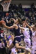Mike Moore | The Journal Gazette Bishop Dwenger junior Xavier Nolan drives to the basket in the first period against Norwell at Norwell High School on Tuesday.   (The_Journal_Gazette)