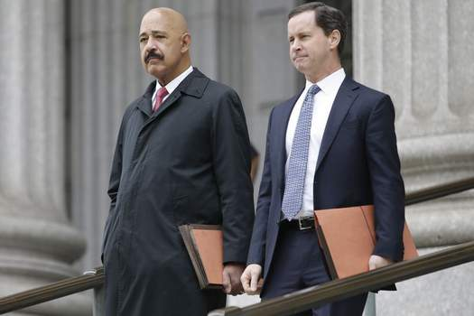 Ted Wells, Jr., left, the lead attorney for Exxon, leaves Manhattan Supreme court with a colleague Thursday, Nov. 7, 2019, in New York. (AP Photo/Frank Franklin II)