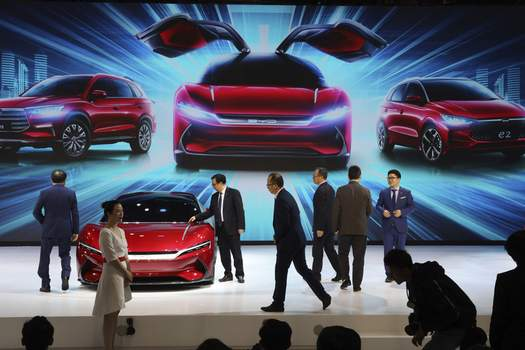 China Electric Car Slump Associated Press photos Cars are seen on display during April's Auto Shanghai 2019 show. Despite a push to produce more electric vehicles, Chinese consumers are shying away from the more expensive technology. (Ng Han GuanSTF)