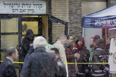 Shooting Jersey City Jersey City's mayor Steven Fulop, center right, talks with first responders at the scene of a shooting in Jersey City, N.J., Wednesday, Dec. 11, 2019. (AP Photo/Seth Wenig) (Seth Wenig STF)