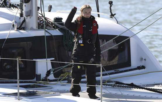 APTOPIX Portugal Thunberg Climate Talks Climate activist Greta Thunberg waves as she arrives in Lisbon aboard the sailboat La Vagabonde Tuesday, Dec 3, 2019. (AP Photo/Pedro Rocha) (Pedro Rocha