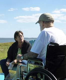 Dying at Home Associated Press Betsy McNair, pictured with her father, Robert, on Virginia's eastern shore in  2009, is proud of the ending she helped give him after his lung cancer diagnosis. (Paul McNairHONS)