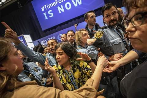 Spain Climate Talks Associated Press photos Demonstrators scuffle with UN security  Wednesday during a protest at the COP25 summit in Madrid.  Over 100  activists led by representatives of indigenous peoples from Latin and North America made their way to the venue.  (Bernat ArmangueSTF)