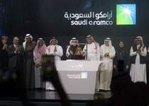 Saudi Aramco Associated Press photos Saudi Arabia's state-owned oil company Saudi Aramco and stock market officials celebrate during the official ceremony marking the debut of Aramco's initial public offering on the Riyadh's stock market Wednesday.  (Amr NabilSTF)