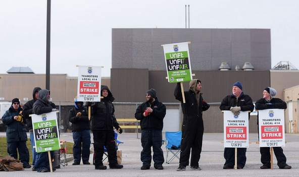 Katie Fyfe | The Journal Gazette          Teamsters Local 414 drivers, warehouse and maintenance workers go on strike this morning at the Fort Wayne United Natural Foods, Inc. distribution center.