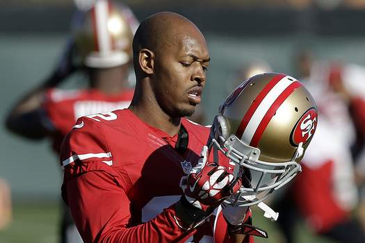 Ex Players Charged FILE - In this Jan. 15, 2014 file photo, San Francisco 49ers cornerback Carlos Rogers adjusts his helmet during practice at an NFL football training facility in Santa Clara, Calif. (AP Photo/Jeff Chiu) (Jeff Chiu STF)