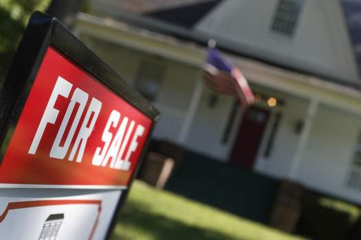 Mortgage Rates FILE - This June 20, 2019, file photo shows an existing home is offered for sale in Rutledge, Ga. (AP Photo/John Bazemore, File) (John Bazemore STF)