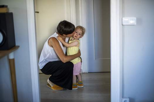 Spain Childbirth Practices In this photo taken on Wednesday, June 19, 2019, Clara Massons kisses her two years old son Jaume at her home in Barcelona, Spain. (AP Photo/Emilio Morenatti) (Emilio MorenattiSTF)