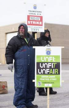 Katie Fyfe | The Journal Gazette Teamsters picket Thursday morning at the Fort Wayne United Natural Foods, Inc. distribution center on Executive Boulevard. The union says the company is violating worker rights. The company says the union ignored its bargaining efforts.