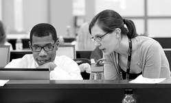 File Manchester University instructor Jennifer Hendriksen works with student Dantê Pavon during a class at the College of Pharmacy on the college's Fort Wayne campus in 2015.